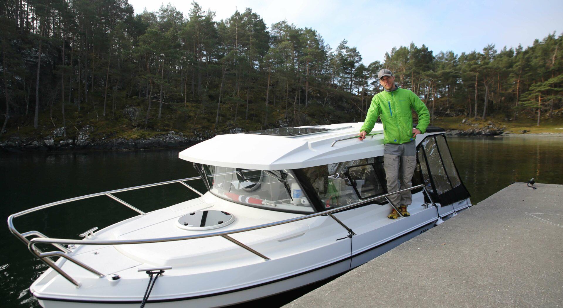 André med båten